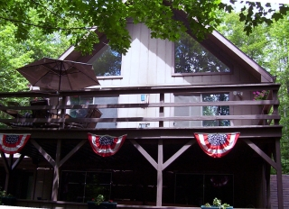 Summer view of Snowman Cabin in Gaylord Michigan.